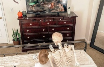 Unlikely Duo of a Toddler and a Skeleton Toy Is Warming Hearts