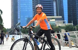 Parent Herald - Determined to give back to society, foreign domestic helper Jannah Pascua runs and cycles to raise funds
