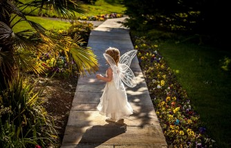 neighbor pretends to be fairy for lonely toddler, neighbor acted to be a fairy for toddler, neighbor saw a fairy garden created by toddler