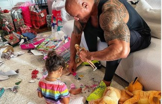 The Rock playing with his daughter.