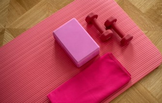 Dumbbells and a yoga mat are great equipment for a working from home exercise routine.