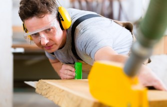 using saw with safety equipment