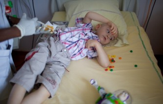 Child in cancer ward undergoing chemotherapy.