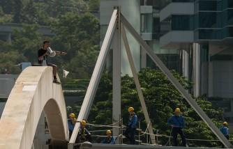 man on top of a bridge