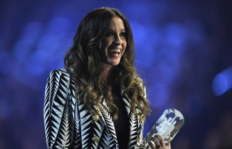 Alanis Morissette is presented an award at the 2015 JUNO Awards at FirstOntario Centre on March 15, 2015 in Hamilton, Canada.