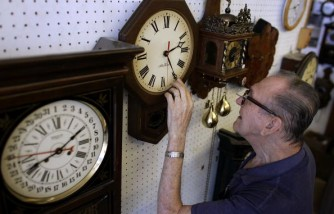 A businessman is preparing to reset clocks for Daylight Saving Time.