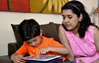 Kid Using Ipad Under Parental Supervision