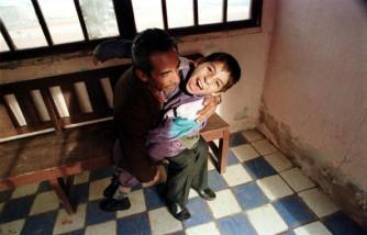 Juan Cuenca holds 19 November 1994 his nine-year-old