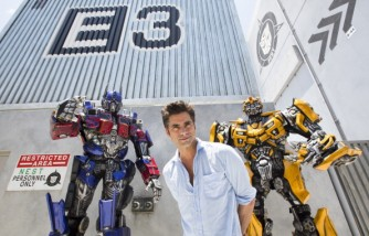 Actor John Stamos Poses With Autobots, Optimus Prime And Bumblebee At Universal Orlando