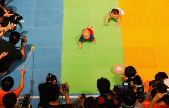Babies crawl during a baby crawling race in Shanghai, China.