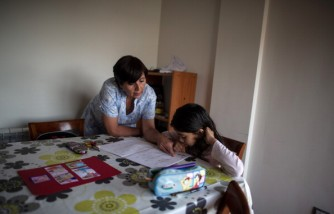 Doris Perez helps her 7-year-old grandchild Katalina with her homeworks at their newly-constructed apartment building.