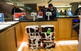 Stacks of Microsoft's Xbox One gaming console are seen at the company's 'pop-up shop' at the Time Warner Center at Columbus Circle in New York City.