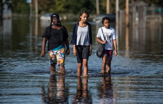 North Carolina Residents Clean Up From Flooding As Waters Continue To Rise Throughout Region Of State