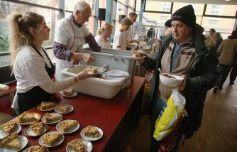 President Gauck Visits Berlin Soup Kitchen